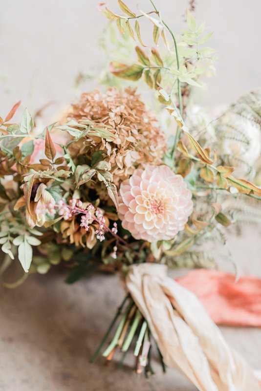 autumn hand tied flower bouquet with pompon or ball dahlia, hydrangea and foliage - Flowers by Firenza flowers, fine art wedding photography by Cristina Ilao Photography