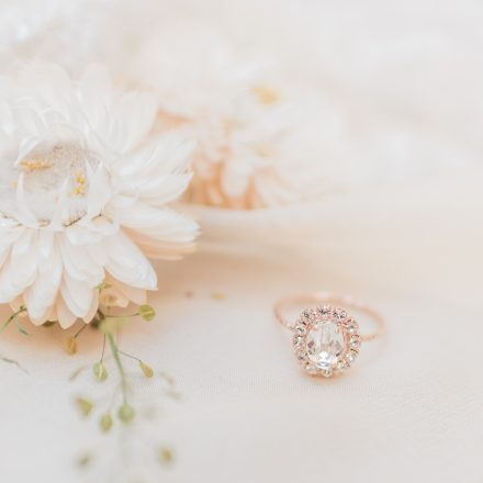 Duchess Engagement Ring by Sparkle La Vie styled with white paper flowers - Photo by fine art wedding photographer Cristina Ilao