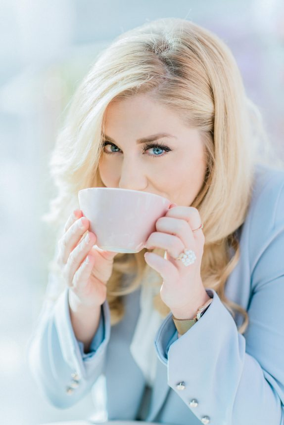 blonde woman with blue eyes sipping a cup of hot chocolate outside peggy porschen parlour in belgravia. In photo: dancing on Ice professional skater alex murphy