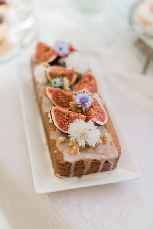 2019 Wedding Trend Luxury Patisserie Table: The Patisseria by MonAnnie Cakes and Alexandra Rose Weddings. A branding shoot at the Belmond Le Manoir Au Quat Saisons by Filipina fine art destination wedding photographer Cristina Ilao Photography | In Photo: fruit cake decorated with figs and cornflower