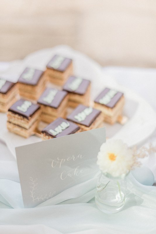 2019 Wedding Trend Luxury Patisserie Table: The Patisseria by MonAnnie Cakes and Alexandra Rose Weddings. A branding shoot at the Belmond Le Manoir Au Quat Saisons by Filipina fine art destination wedding photographer Cristina Ilao Photography | In Photo: Opera cake
