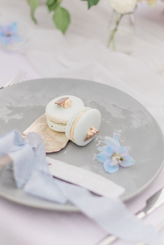 2019 Wedding Trend Luxury Patisserie Table: The Patisseria by MonAnnie Cakes and Alexandra Rose Weddings. A branding shoot at the Belmond Le Manoir Au Quat Saisons by Filipina fine art destination wedding photographer Cristina Ilao Photography | In Photo: mint green pistachio french macarons, vintage brass cake serving spoon, pale blue silk ribbon, pale grey ceramic plate, blue and grey wedding theme