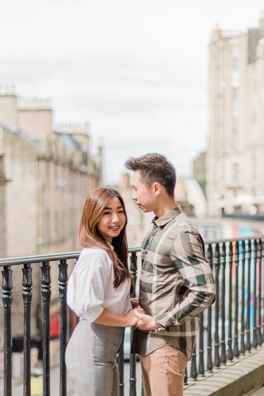 This photo was taken during an engagement shoot at Victoria Street. This street is known for its colourful stores, beautiful architecture, local pubs and cafes.  Photo by fine art destination wedding and lifestyle photographer Cristina Ilao of Cristina Ilao Photography. See more at www.cristinailao.com.  Tags: Edinburgh wedding photographer, UK destination wedding photographer, Victoria Street, Photo spots in Edinburgh, fine art weddings, Edinburgh elopement, pre-wedding, post-wedding lifestyle session, lifestyle photographer, UK lifestyle blogger