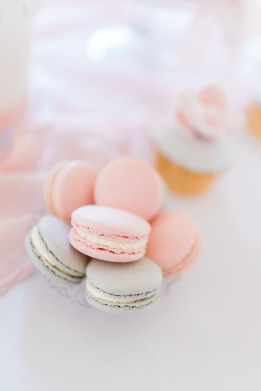 Classy bridal shower party ideas: luxury dessert tasting, patisserie table. In Photo: pink and grey French macarons by Sadie May Cakes | Photo by Cristina Ilao Photography