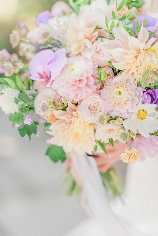 Classy bridal shower party ideas: Hand-tied flower workshop. In Photo: wedding bouquet with orchids, dahlias, roses in pastel colours. Photo by Cristina Ilao Photography www.cristinailao.com