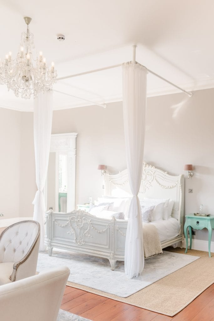 beautiful light and airy French bedroom inspired bridal suite at Thicket Priory wedding venue in North Yorkshire. Photo by Cristina Ilao Photography
