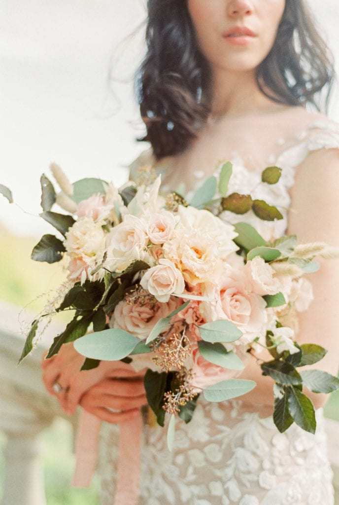 the prettiest wedding bouquet with various pink and peach roses by Bloom Your Life. Shot on film by Cristina Ilao Photography. www.cristinailao.com