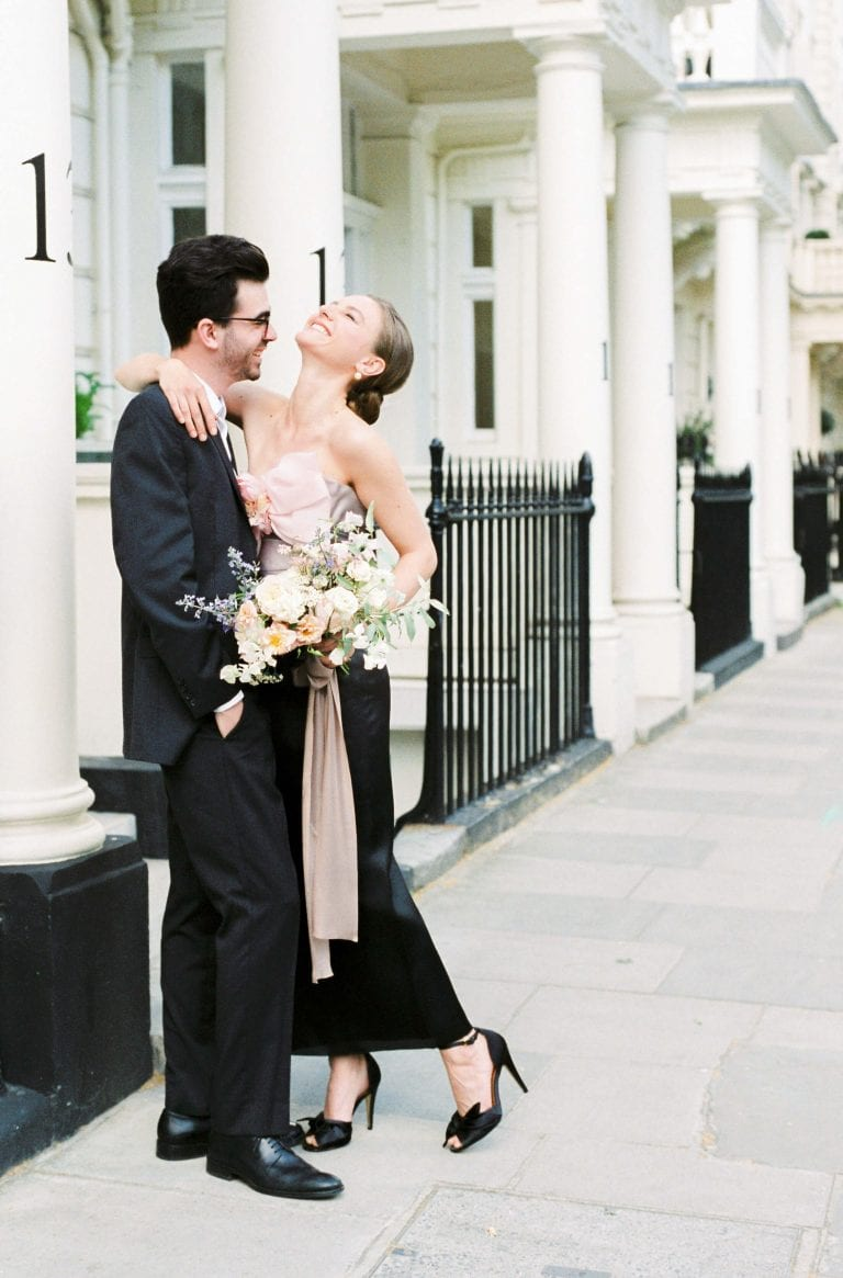 Engagement shoot in Kensington, London featuring a pink, grey and black Marchesa off-shoulder ombre silk gown and black Bella Belle silk peep toe evening shoes. Flowers by Lucy the Flower Hunter, styling by East Made Co, Photo by Cristina Ilao.