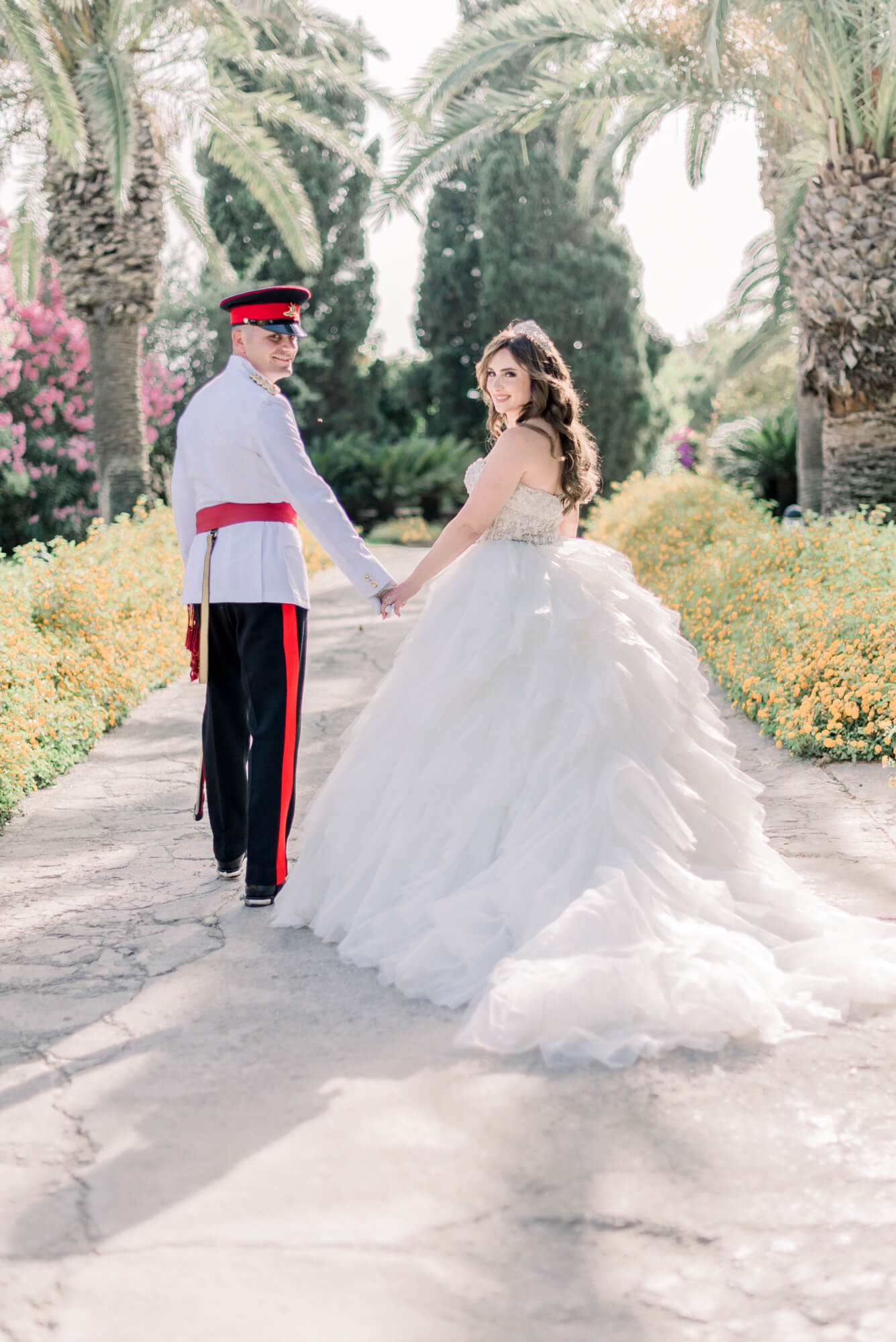 Practical tips on how to choose your wedding photographer. In Photo: bride and groom walking away and looking back. Bride wearing an Randy Fenoli princess style ball gown tulle wedding dress and groom wearing a Malta full military outfit. Shot at Search Results Web results Ir-Razzett L-Abjad in Malta by fine art destination wedding photographer Cristina Ilao | www.cristinailao.com