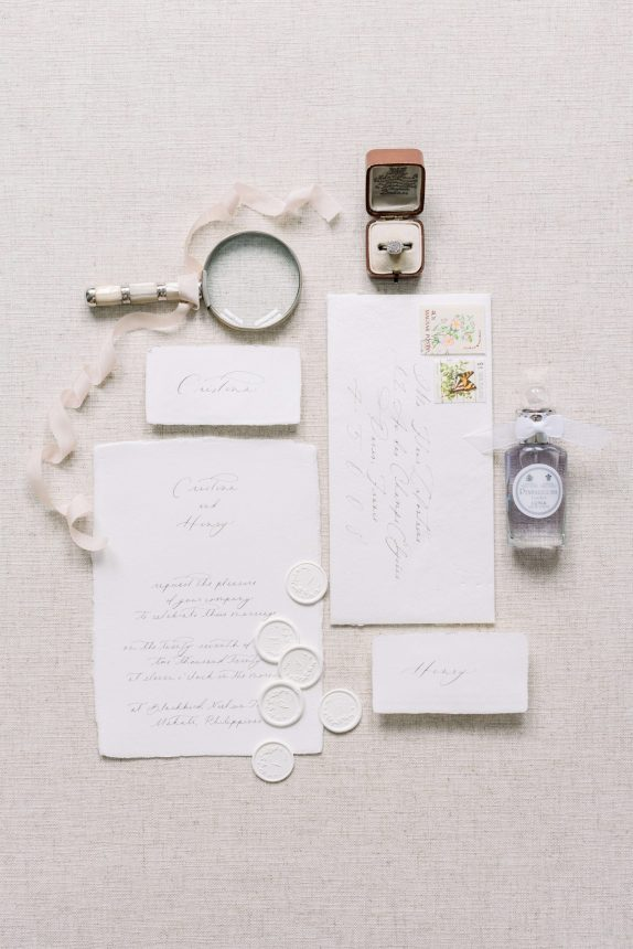Fine Art Branding and Product Photography for wedding stationery by vellume - using handmade paper, penhaligon's luna, antique magnifying glass, hand-dyed silk ribbon, vintage engagement ring on a victorian ring box