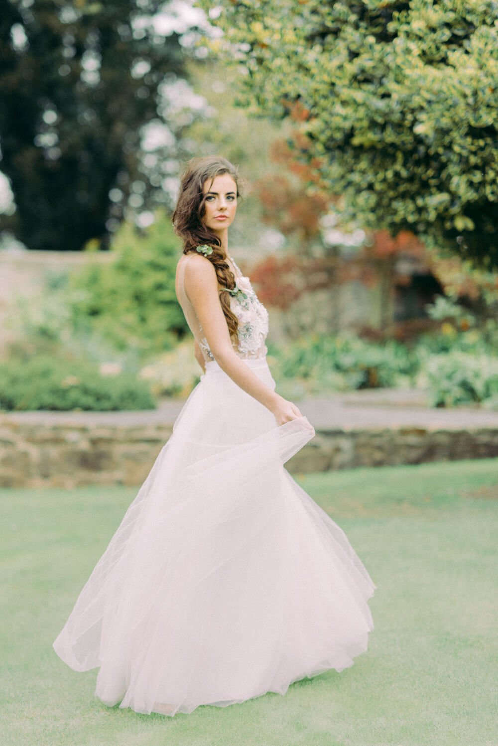 elegant dancing bride with A line style white wedding dress