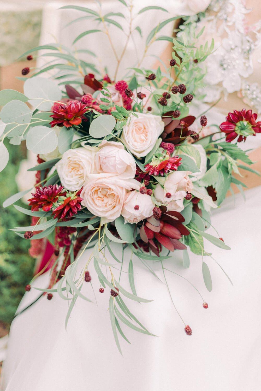 big blush blousy roses with burgundy dahlia accents, eucalyptus leaves autumn bouquet