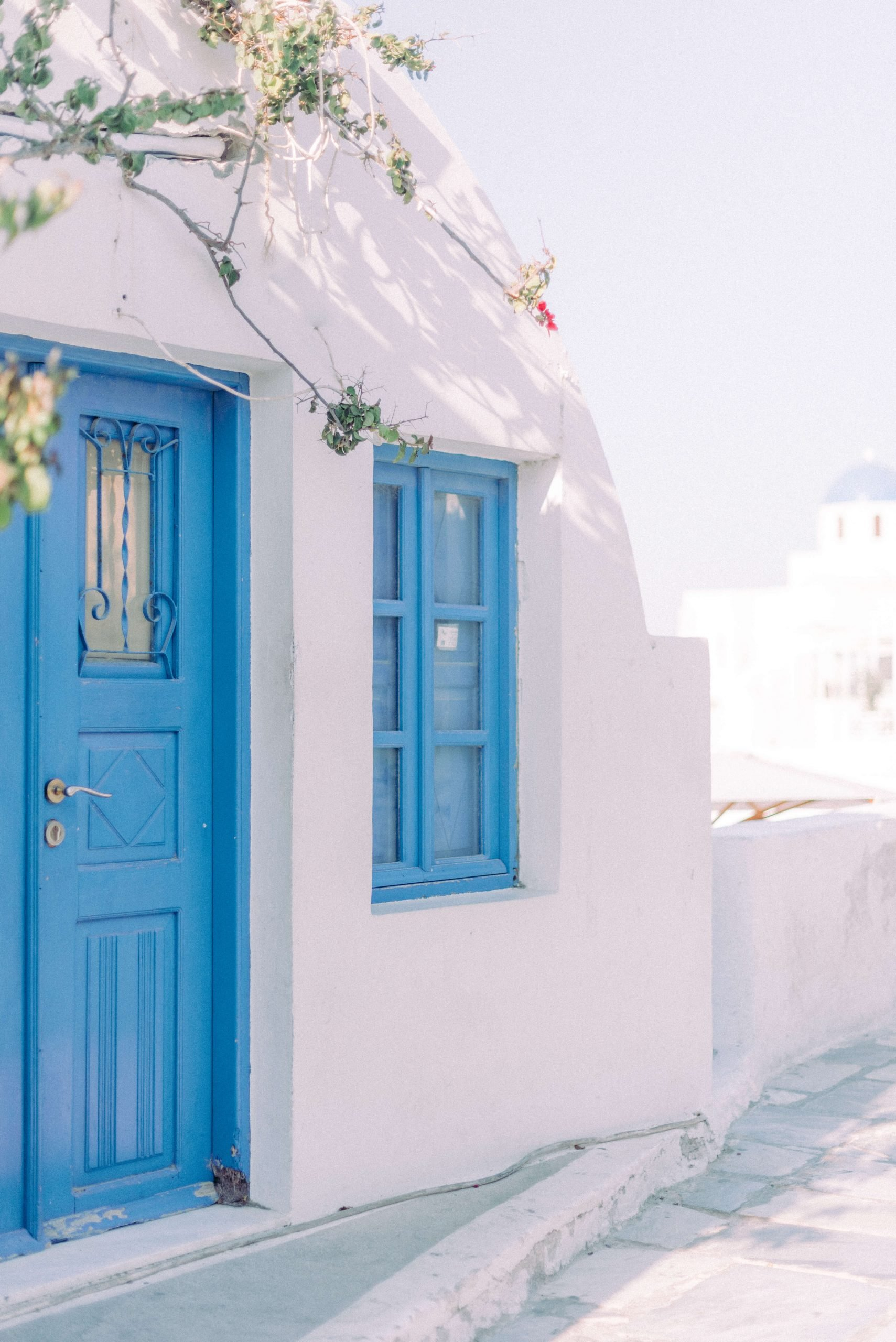 blue doors and white walls, typical Greek houses and buildings, perfect for destination wedding location. Photography by Cristina Ilao www.cristinailao.com