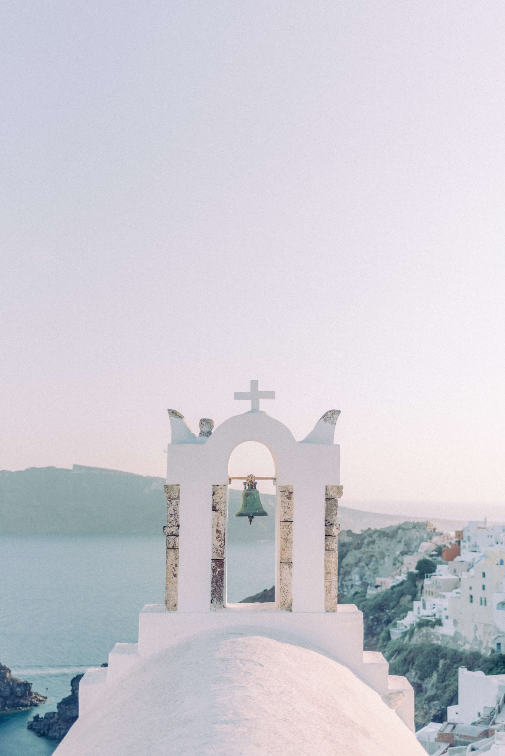 Oia Santorini church bell tower and cross Photography by Cristina Ilao www.cristinailao.com