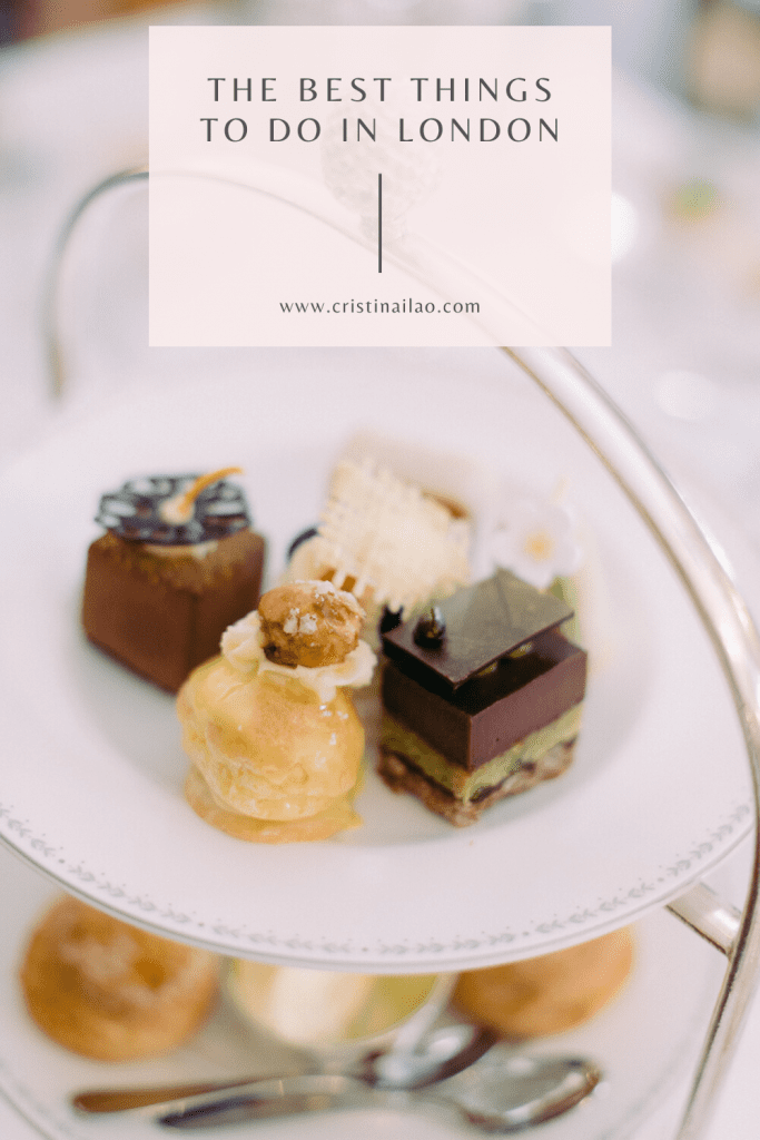 afternoon tea at the Ritz London - gold tray with profiterole, miniature cakes and scones below