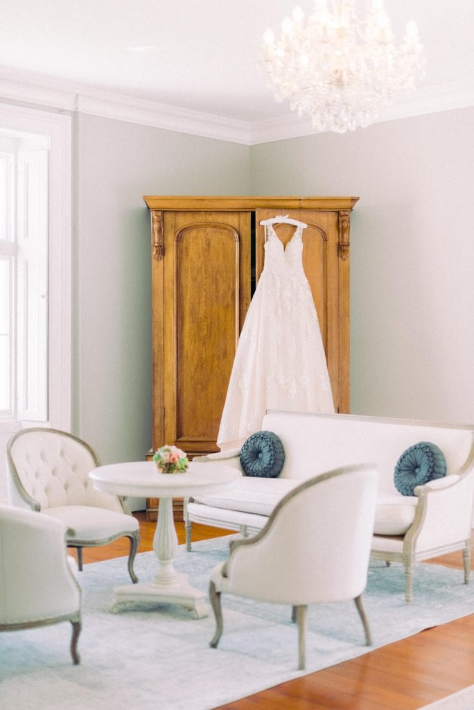 fine art wedding and bridal suite with light and airy vibe. Buckingham Suite at the Thicket Priory with French furniture and ornate Crystal chandelier. Photo by destination wedding photographer Cristina Ilao. www.cristinailao.com