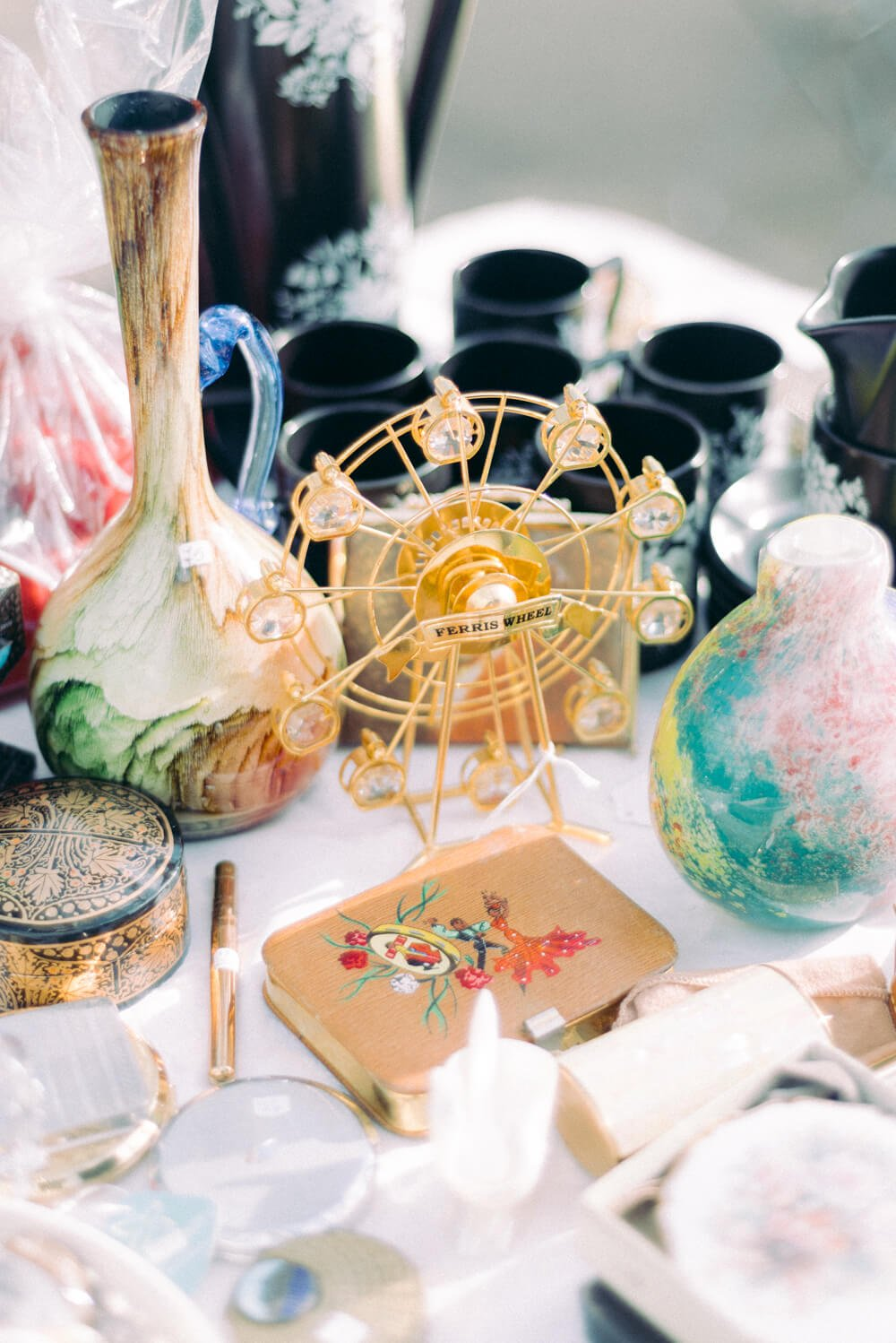 Antique products sold at the London Covent Garden Jubilee antiques market: Gold ferris wheel and vintage jewellery boxes with fine porcelain and china wares - Photo by Cristina Ilao