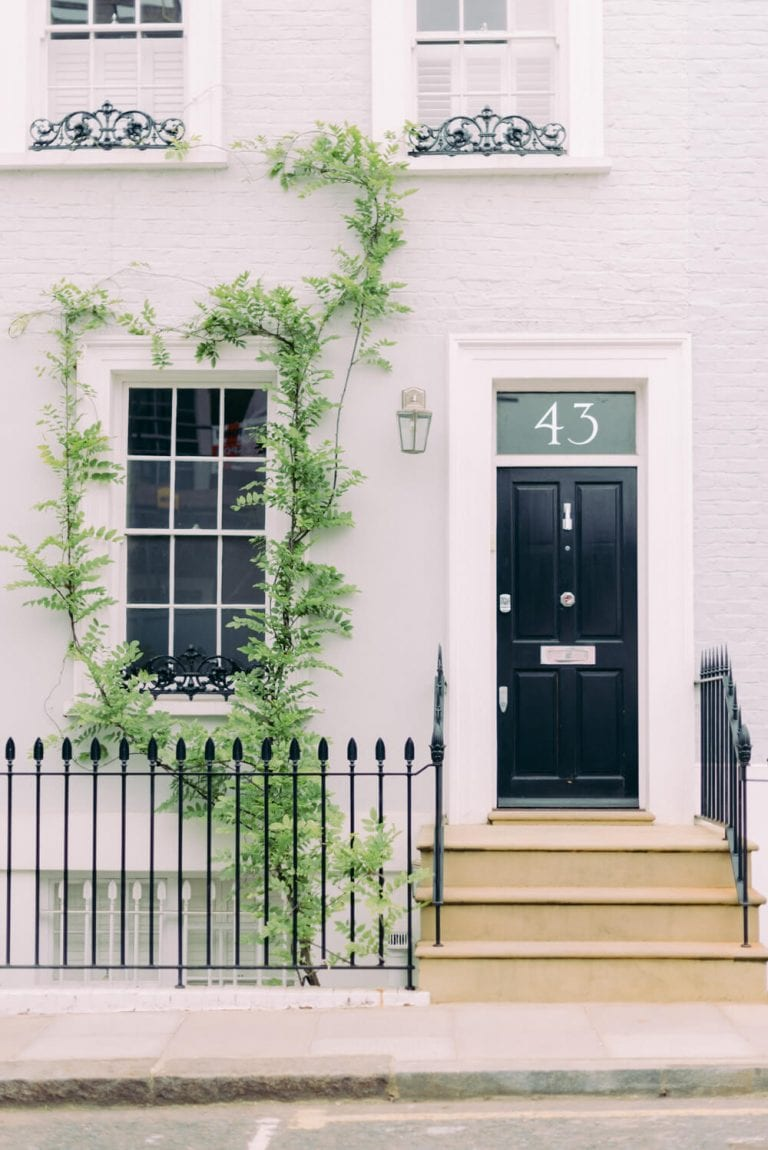 Victorian house number 43 in Belgravia with big number on the door and a wisteria vine around the big window - Photo by Cristina Ilao