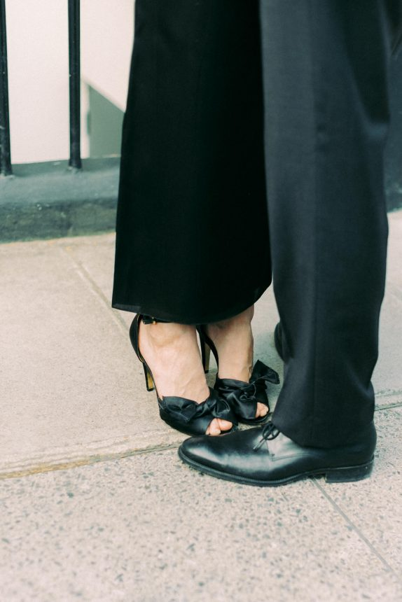 black formal male shoes and black satin BCBG Max Azria high heels