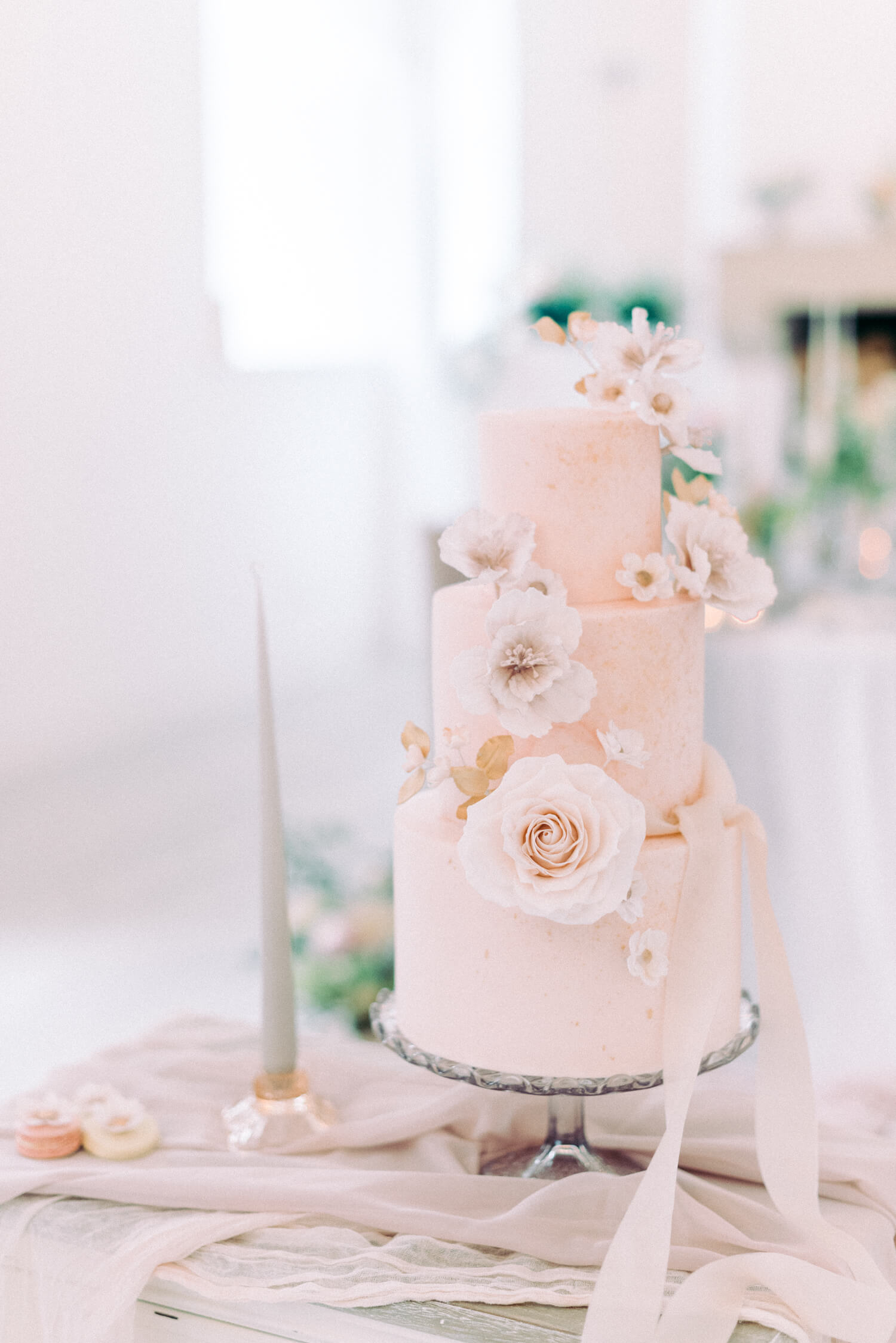 autumn wedding  - 3 tier dreamy peach themed fondant with white roses and sugar flowers on crystal stand. designed by sadie may cakes, photo by cristina ilao photography, venue: brinkburn northumberland priory