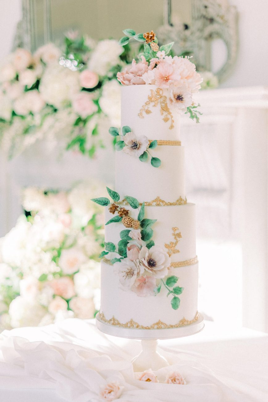 spring wedding cake ideas - four tier wedding cake with sugar flowers including pink peonies, white anemonies, green eucalyptus and foliage. cake by sadie may cakes, photo by cristina ilao photography, venue: thicket priory