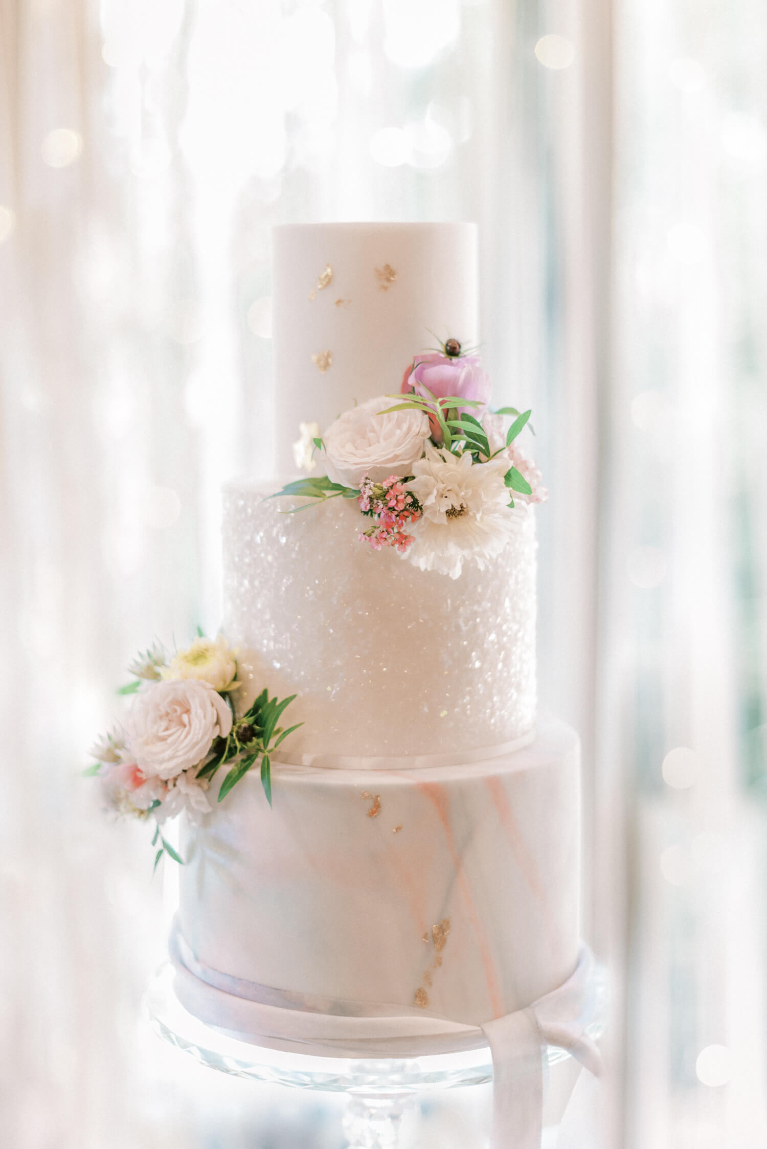 beautiful summer wedding cake ideas - three tier wedding cake with marbled layer, sugar crystal layer and gold leaf layer decorated with real flowers. cake by storeybook cakes and photo by cristina ilao photography