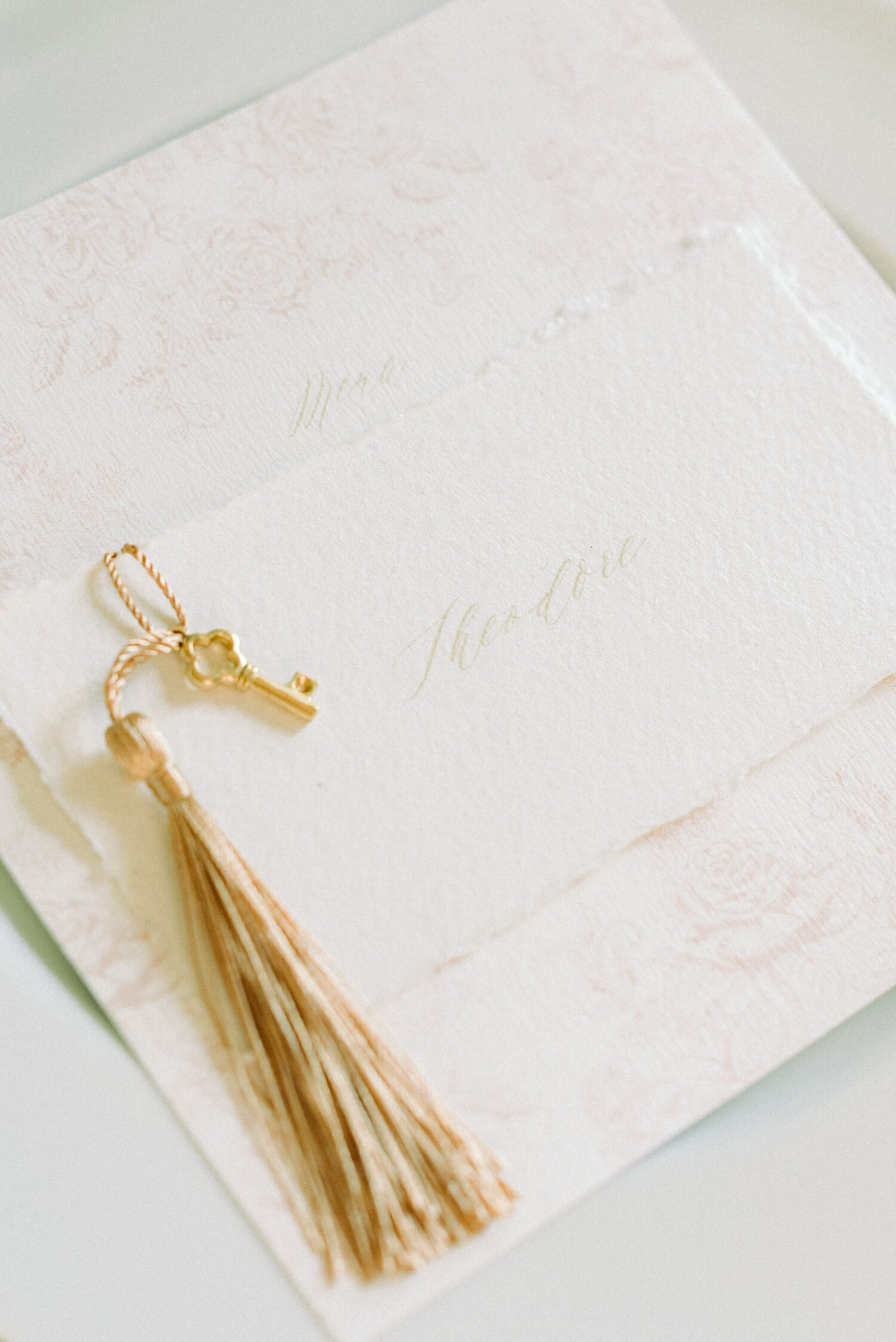 Katie Sue Design Co handmade Paper Place setting with gold tassel and key for Thicket Priory wedding editorial by Cristina Ilao www.cristinailao.com
