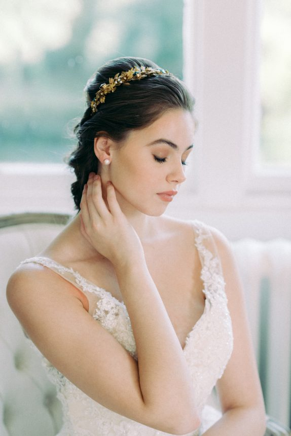 Bridal fresh and natural muted palette make-up look with braided/plaited hair and adorned with a golden brass tiara