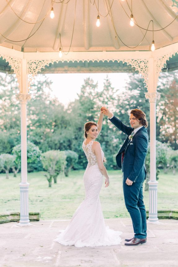 bride and groom dancing at bandstand after intimate wedding