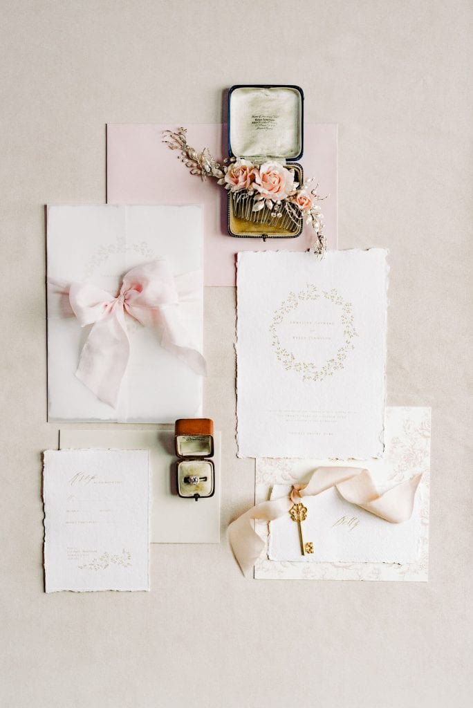 flatlay goals for a Victorian period inspired wedding, stationery by Katie Sue Design Co, silk ribbons by Silk & Purl, rose hair accessories by What Katy Did Next- Photo by fine art wedding photographer Cristina Ilao www.cristinailao.com