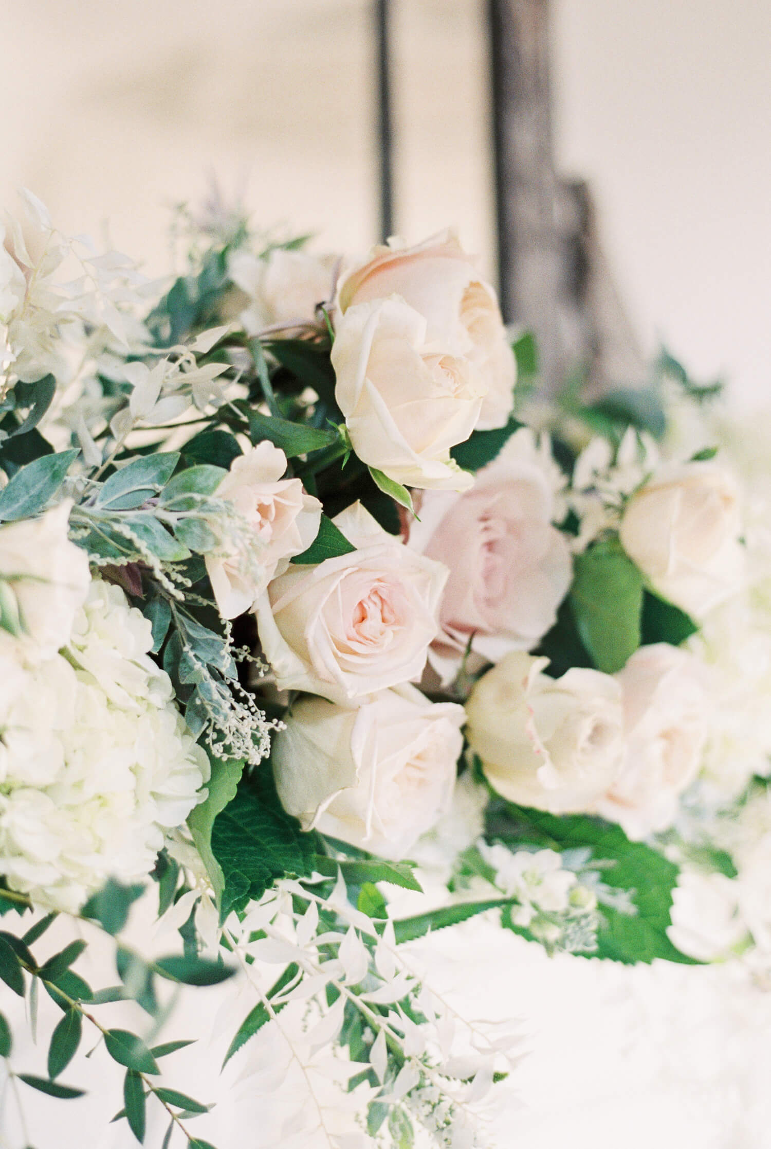 big blousy roses for fine art floral wedding installation with muted colour palette by Flori & Fern for fairytale Thicket Priory Wedding - Photo by Cristina Ilao www.cristinailao.com