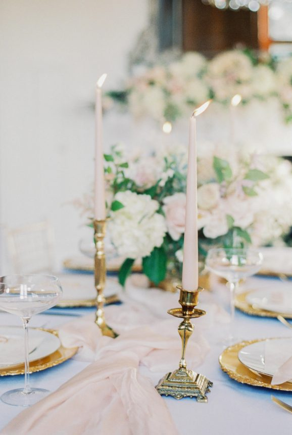 vintage brass candle holder with blush ester and erik tapered candles- Photo by fine art wedding photographer Cristina Ilao www.cristinailao.com