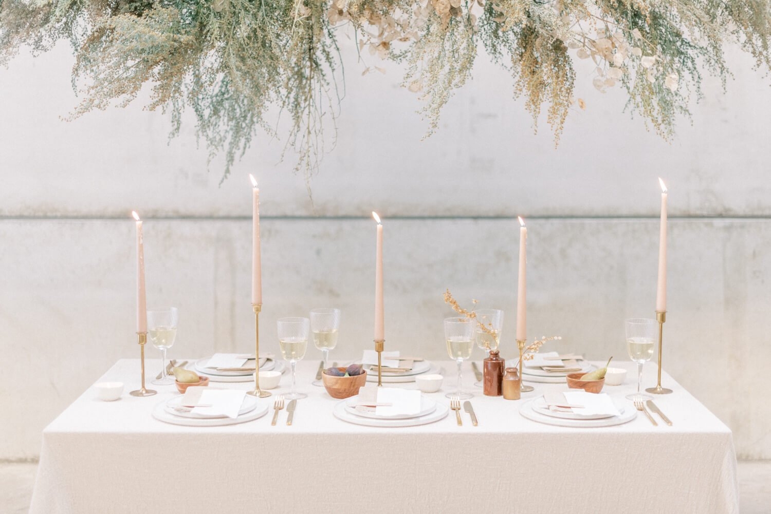 English Countryside Autumn Wedding at a Flower Farm | Photos and Text by Cristina Ilao Photography | In photo: minimalist destination wedding table arrangement with brass candlesticks and neutral colour themed crockery