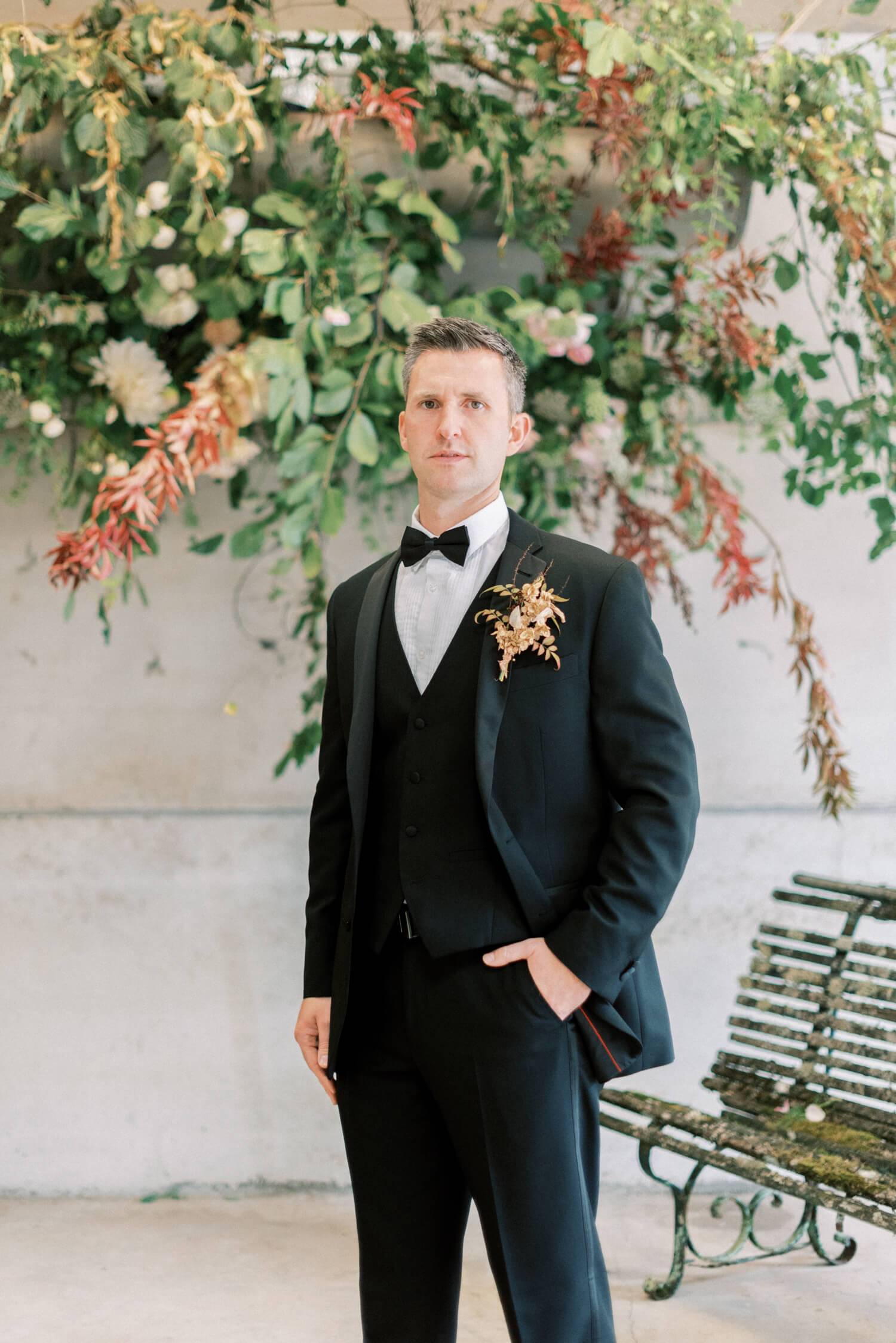 English Countryside Autumn Wedding at a Flower Farm | Photos and Text by Cristina Ilao Photography | In photo: groom wearing a black tuxedo with an autumn boutonniere