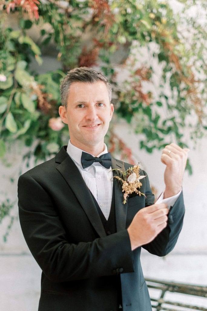 English Countryside Autumn Wedding at a Flower Farm | Photos and Text by Cristina Ilao Photography | In photo: groom wearing a black tuxedo with autumn boutonniere