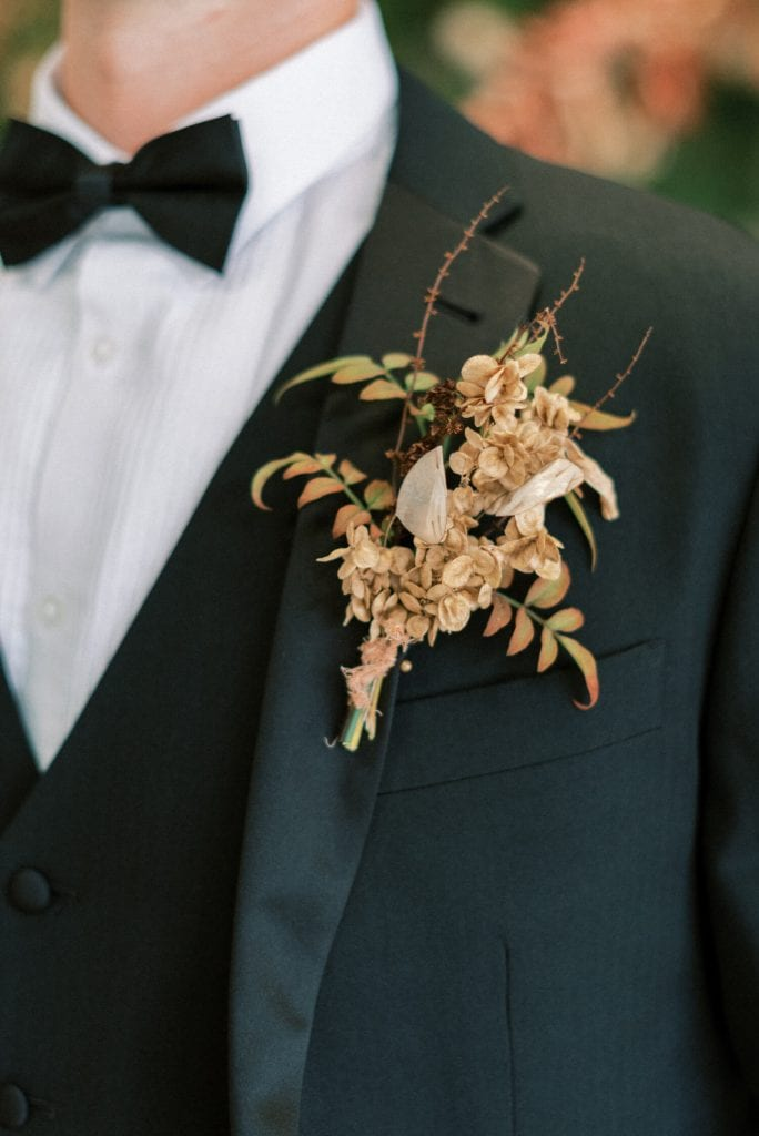 autumn wedding boutonniere with honesty and dried foliage