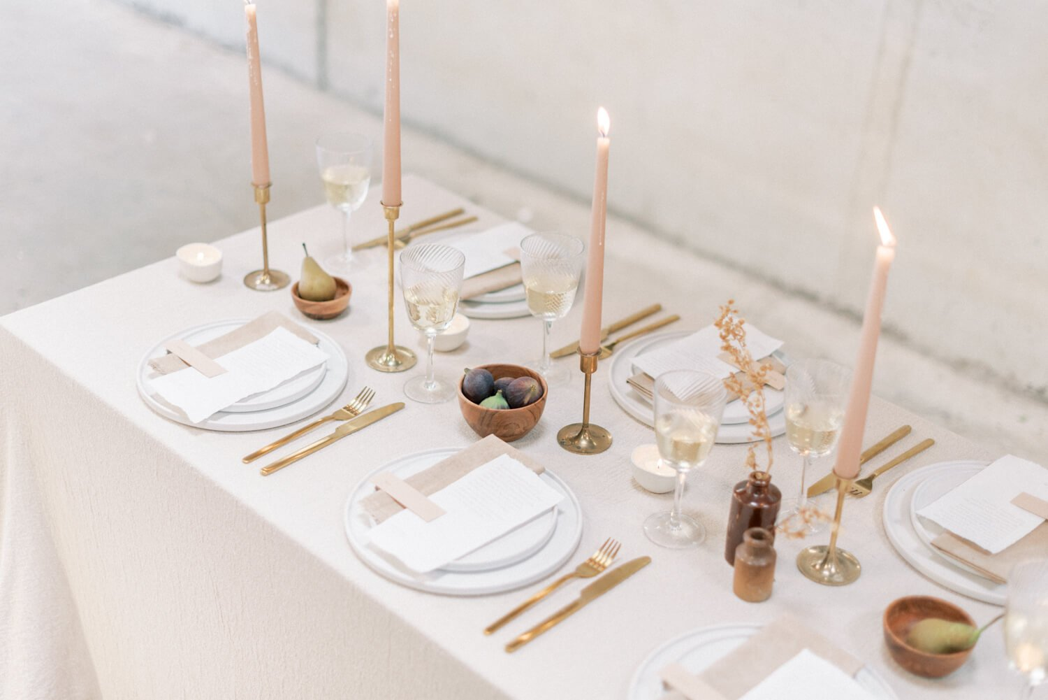 Wedding Photography FAQs In photo: English Countryside Autumn Wedding at a Flower Farm | Photos and Text by Cristina Ilao Photography | In photo: minimalist destination wedding table arrangement with brass candlesticks and neutral colour themed crockery