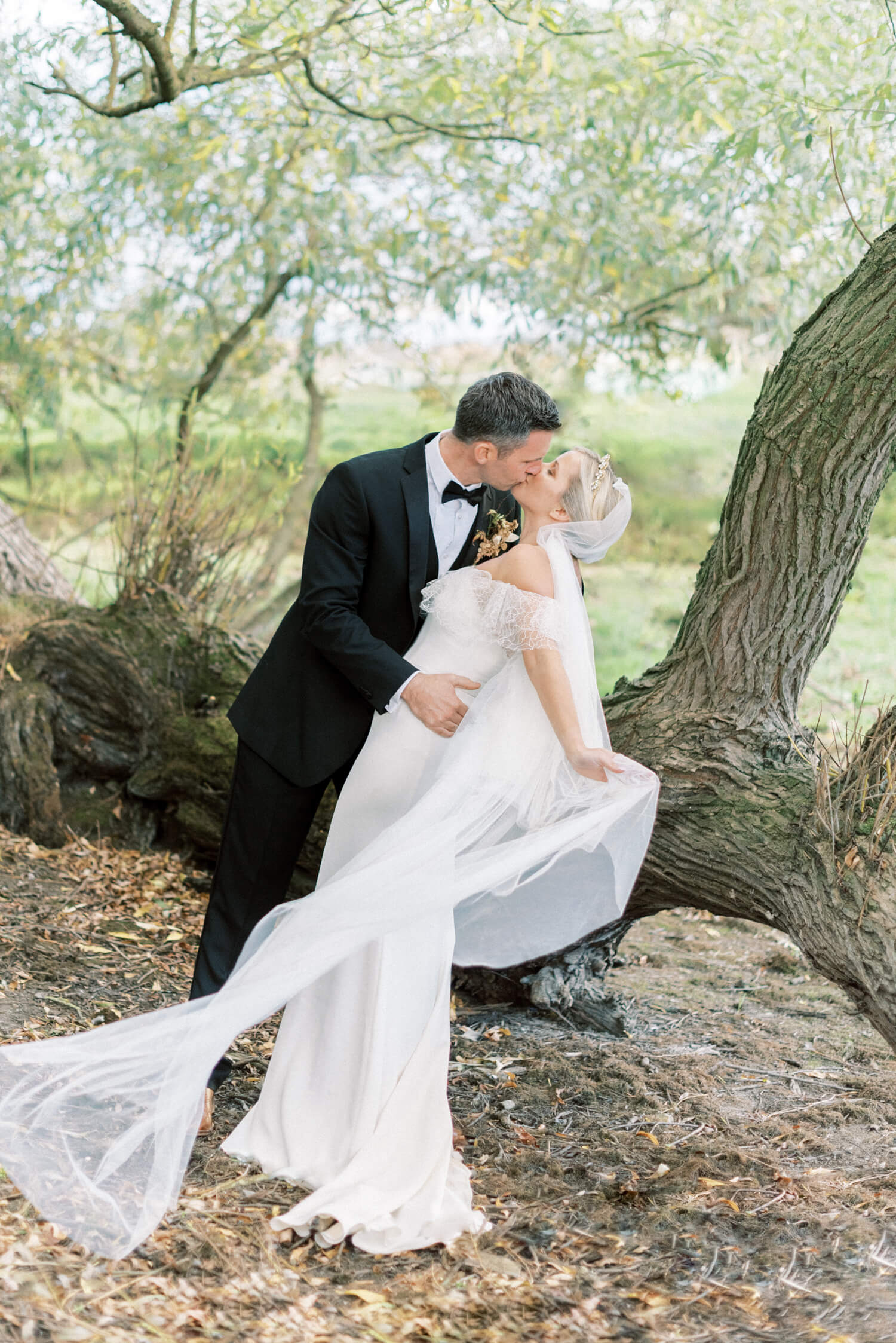 Cherry Williams London custom off-shoulder mermaid wedding gown with soft tulle veil