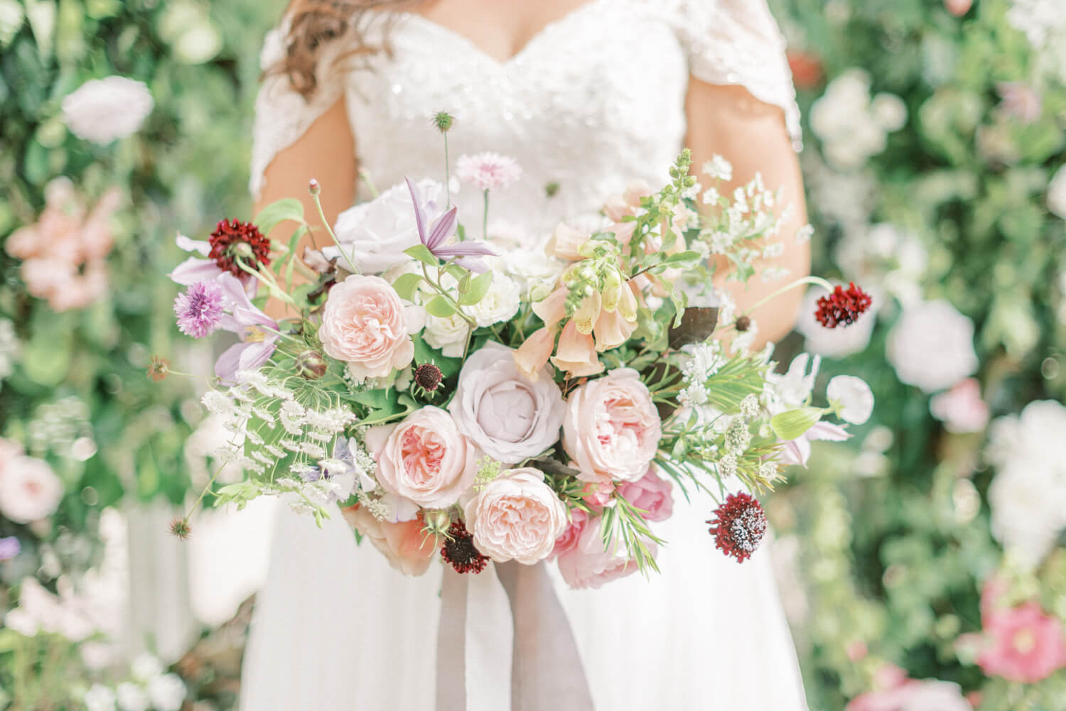 Wedding Photography FAQs In photo: bridal wildflower bouquet by All Bunched Up. Photo by Cristina Ilao