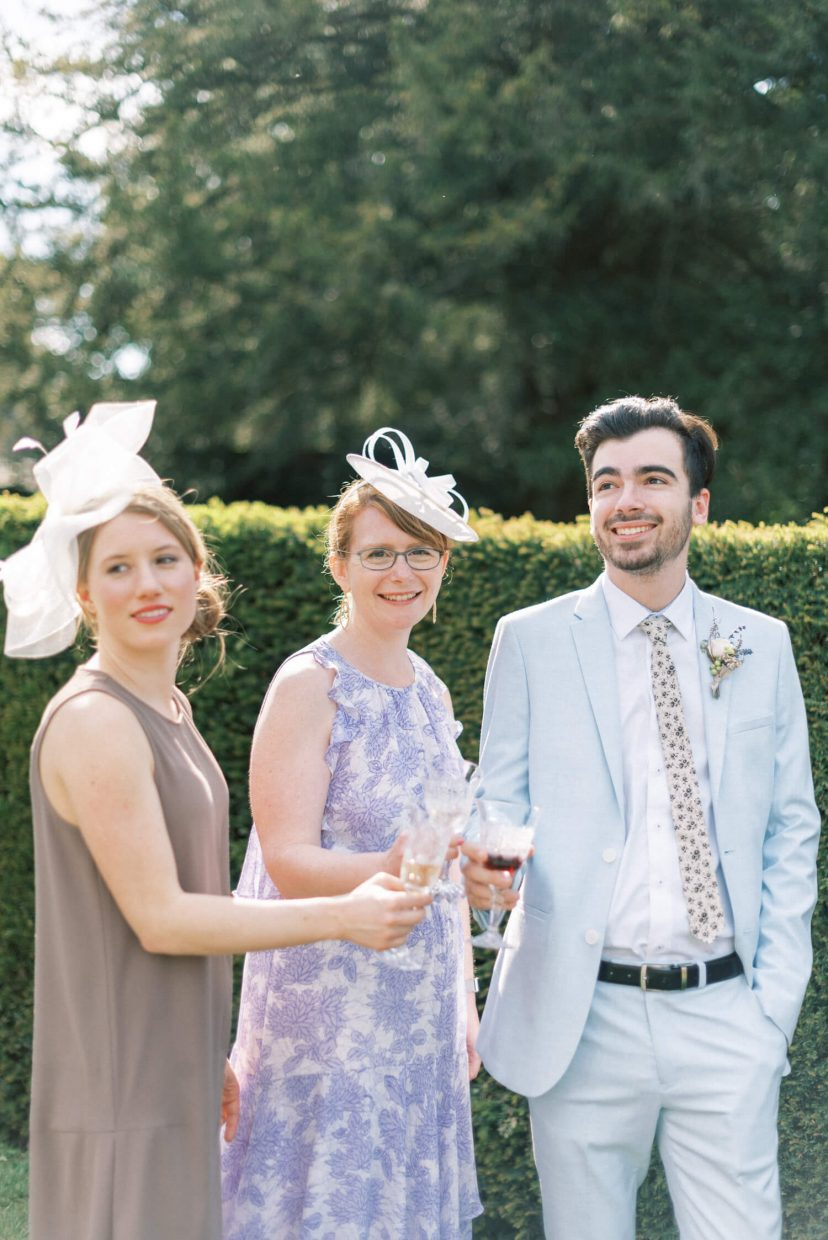 hedsor house spring summer wedding inspiration with guest photos; guest wearing floral lavender print summer ruffled dress and fascinator; guy wearing pale blue suit with floral tie | Photo by London and Newcastle UK based light bright and airy Filipina wedding photographer Cristina Ilao