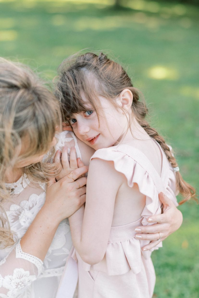 mother and daughter Cottagecore Aesthetic pale pink ruffled linen dungaree ; mini portrait photo session in Wynyard Hall and Gardens - Photo by London family photographer Cristina Ilao
