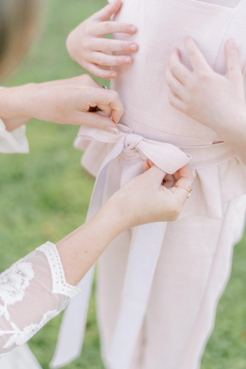 pale blush pink linen dungaree belt tied in a ribbon | Cottagecore Aesthetic Family photo shoot mini session in Wynyard Hall and Gardens by Cristina Ilao Photography