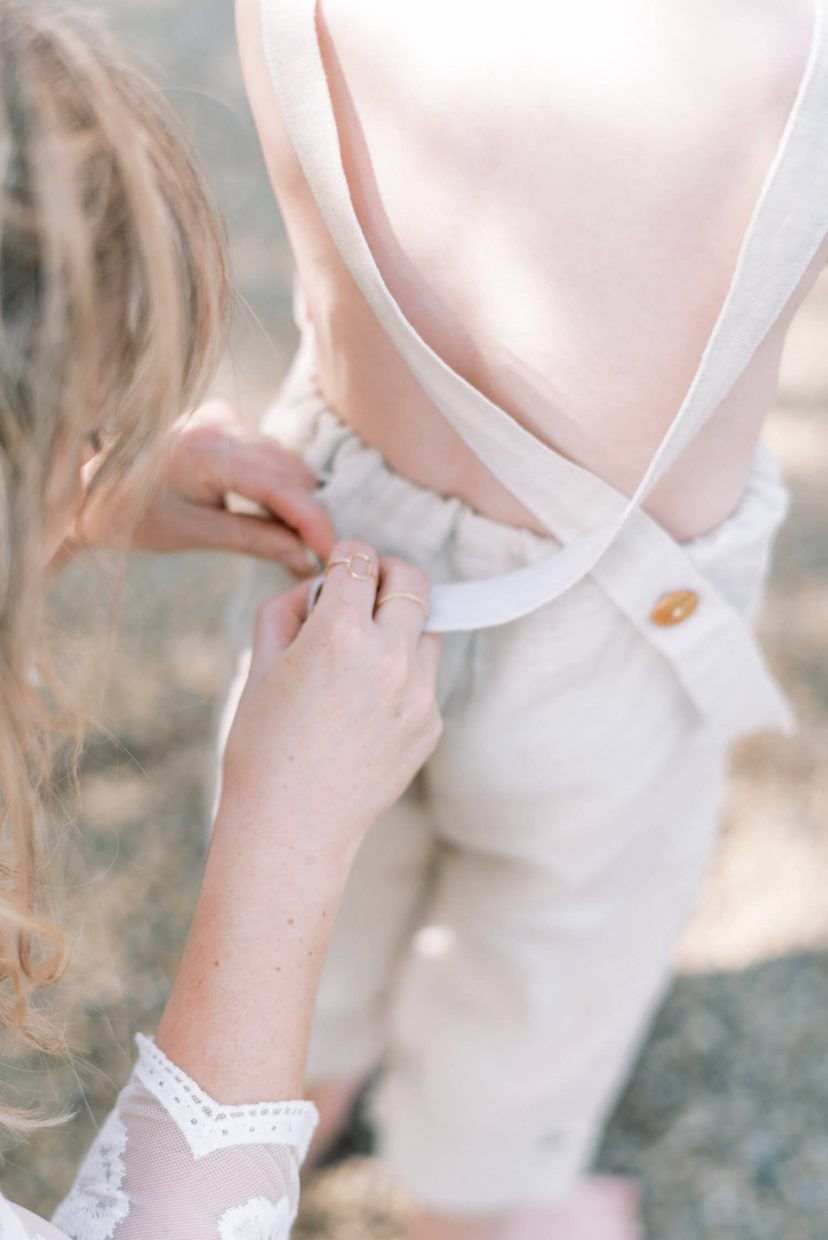 toddler son wearing beige neutral dungaree in linen fabric | Cottagecore Aesthetic Family photo shoot mini session in Wynyard Hall and Gardens by Cristina Ilao Photography