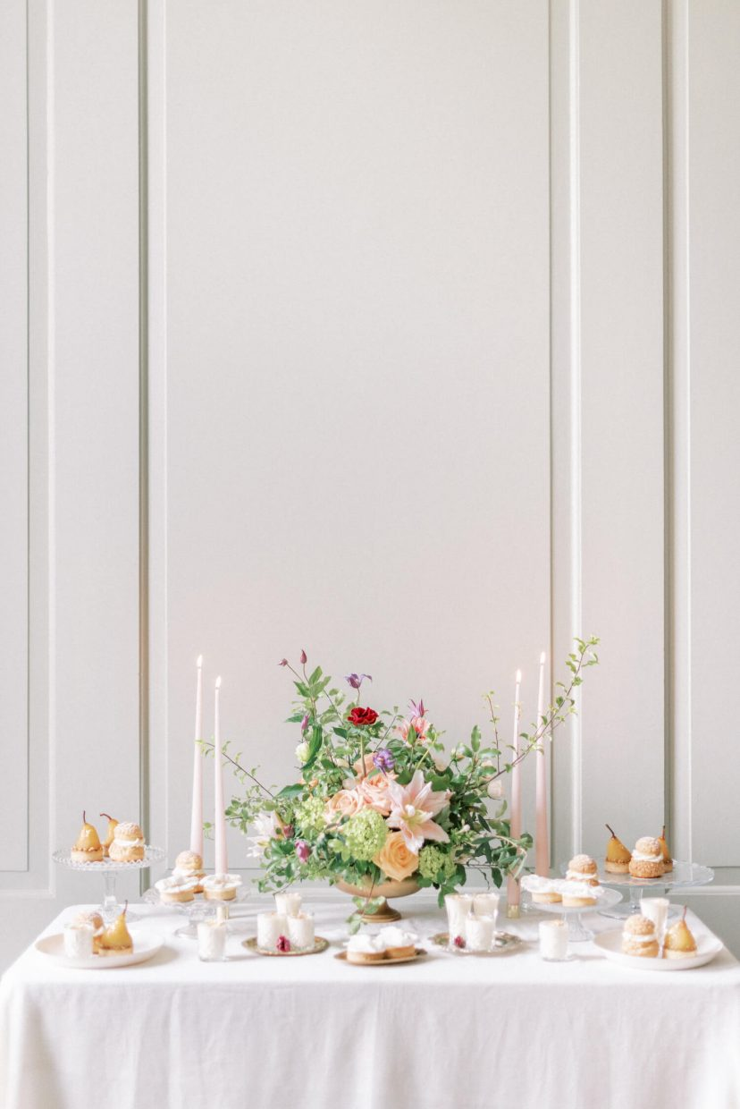 luxury patisserie table by MonAnnie Cakes styled by Alexandra Rose Weddings at Thorpe Manor luxury wedding venue in Oxfordshire; simple floral wedding arrangement for intimate wedding and events; wall panel in white and with high ceilings| Photo by Cristina Ilao Photography. More at www.cristinailao.com