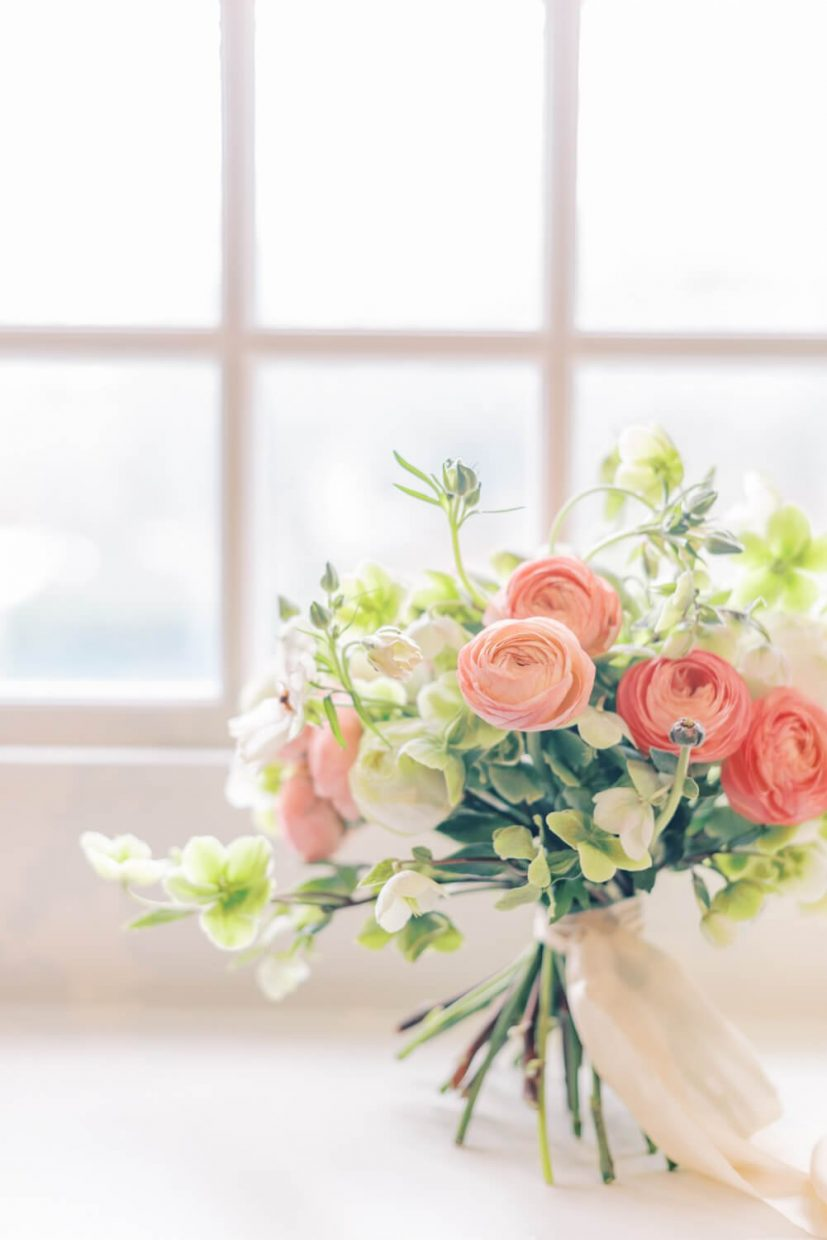 Spring wedding bouquet filled with blush and peach ranunculus and green and white hellebores. Styled by Alexandra Rose Weddings and Photo by Cristina Ilao