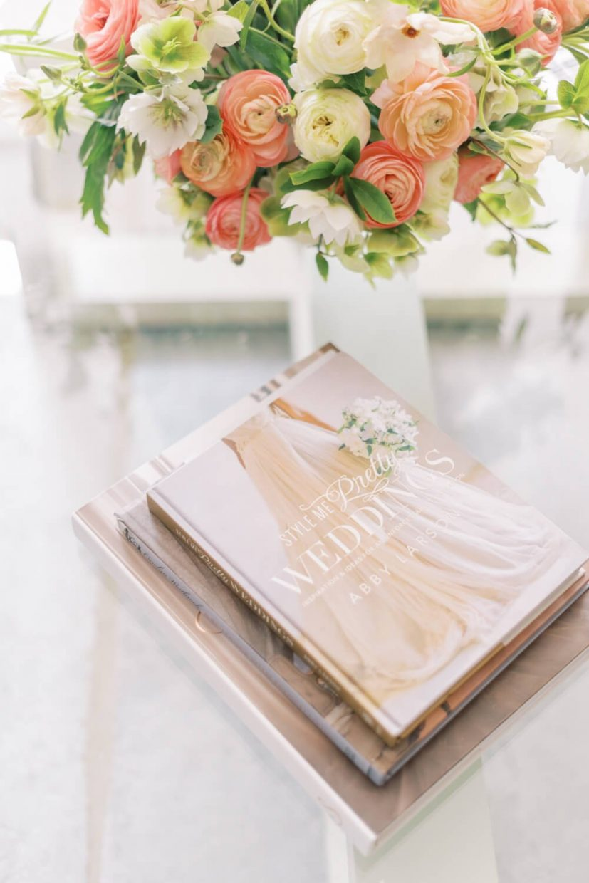 style me pretty wedding inspiration book on a glass table, peach, living coral, blush flowers including ranunculus, hellebores, branding photo session Styled by Oxfordshire Wedding Planner Alexandra Rose Weddings and Photo by London Photographer Cristina Ilao