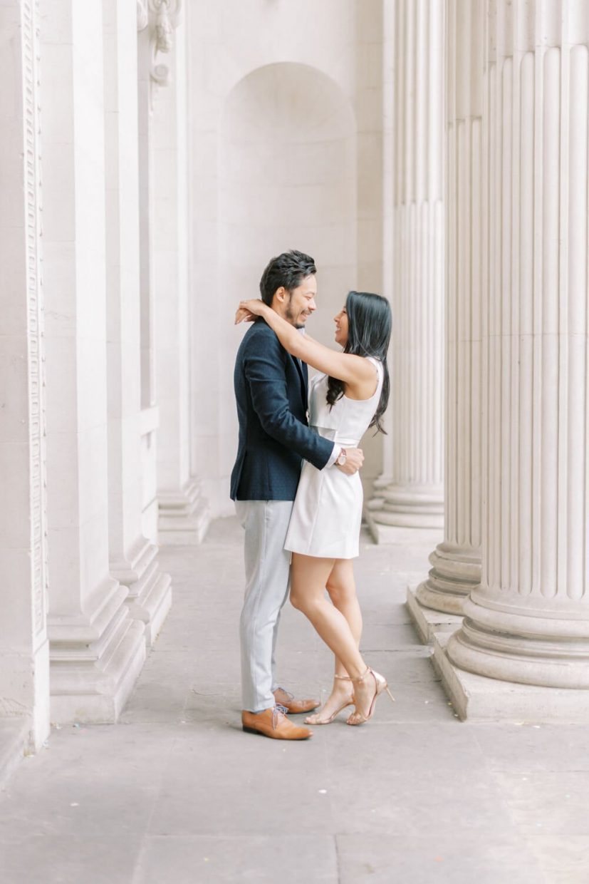 London Engagement Shoot in Kensington & Chelsea Old Marylebone Town Hall by Cristina Ilao Fine Art Wedding Photography   In Photo: Asian Chinese couple engaged session, light-filled hallway entrance portrait, civil registry intimate wedding outfit inspiration
