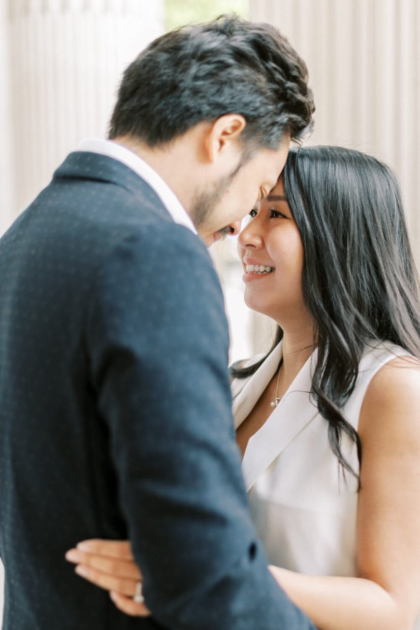 London Engagement Shoot in Kensington & Chelsea 10-11 Carlton House Terrace by Cristina Ilao Fine Art Wedding Photography   In Photo: close up of bride and groom, civil registry ceremony outfit inspiration, long curled black hair, natural make-up, fun and happy approach