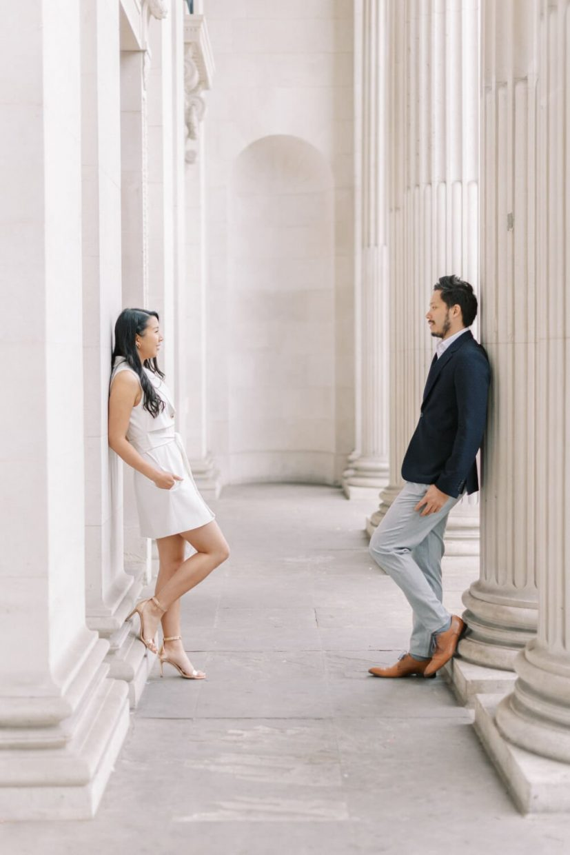 London Engagement Shoot in Kensington & Chelsea Old Marylebone Town Hall by Cristina Ilao Fine Art Wedding Photography   In Photo: couple facing each other posed in the light-filled entrance hallway