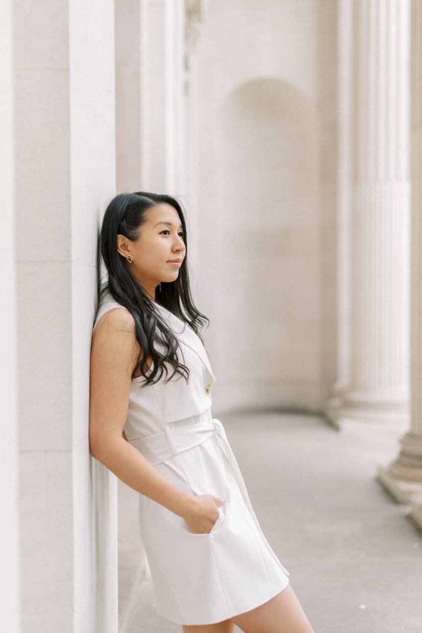 London Engagement Shoot in Kensington & Chelsea Old Marylebone Town Hall by Cristina Ilao Fine Art Wedding Photography   In Photo: fashionable classic white mini dress, civil registry wedding perfect outfit ideas and inspiration, long black curled bridal hairstyle, simple natural make-up